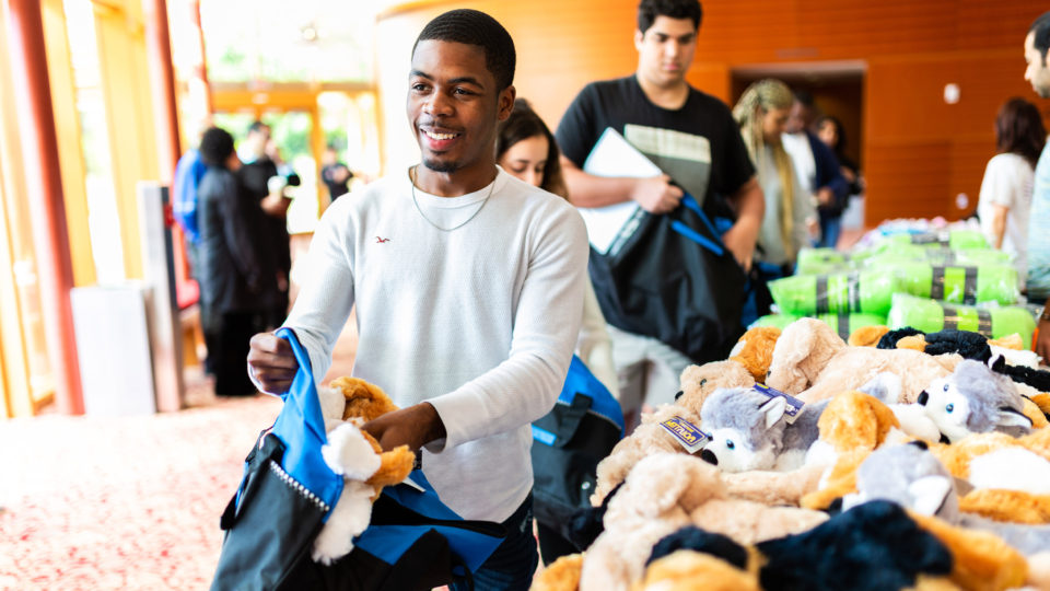Students pack Comfort Cases for children in foster care.
