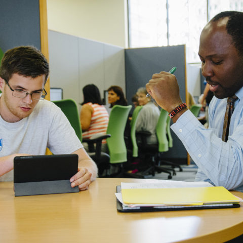 Students with learning differences get academic coaching in the tutoring center.