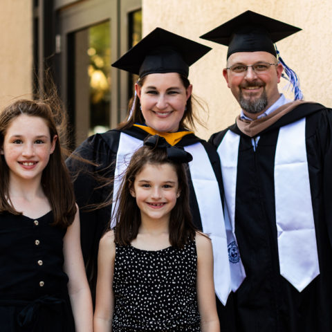 Charles and Suzanne Olvey celebrate graduation with their daughters