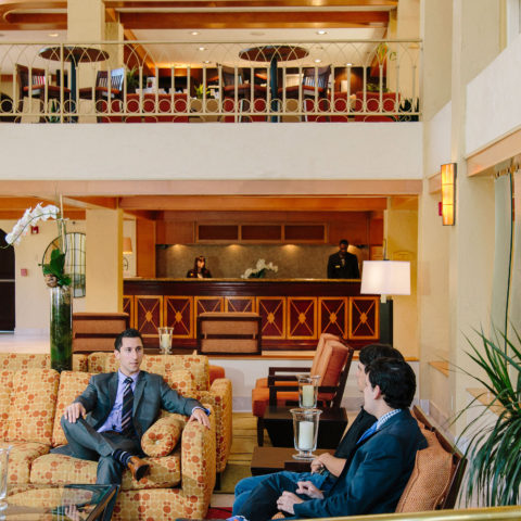 Two people talking in a resort lobby
